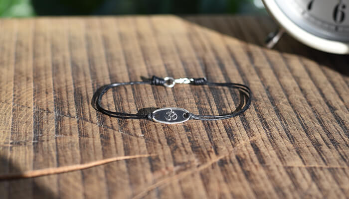 Silver Om Bracelet on waxed cotton #2